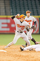 Sam Houston State Bearkats shortstop Jake MacWilliam #10 attempts to turn a double play against the Texas Christian Horned Frogs at Minute Maid Park on February 28, 2014 in Houston, Texas.  The Bearkats defeated the Horned Frogs 9-4.  (Brian Westerholt/Four Seam Images)