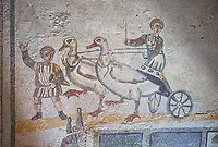 Close up picture of the Roman mosaics of the room of the Small Circus depicting Roman boys riding small chariots pulled by geese in a small circus, The Vestibule of The Smnall Circus, room no 41  at the Villa Romana del Casale, first quarter of the 4th century AD. Sicily, Italy. A UNESCO World Heritage Site.<br /> <br /> The Roman mosaic know as the Small Circus at the Villa Romana del Casale depicts a scene of a chariot race from the Circus Maximus in Rome. Two wheeled chariots, driven by children,  are racing around a central Pina (barrier) being drawn by fowl and web footed birds. The four chariots represent the four factions that raced against each other at the Circus and the tunics of the cild charioteers and the birds pulling their chariots are distinguished by the four different colours used by each faction.