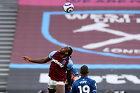 21st March 2021; London Stadium, London, England; English Premier League Football, West Ham United versus Arsenal; Michail Antonio of West Ham United flicks the ball on