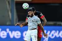 WASHINGTON, DC - NOVEMBER 8: Anthony Jackson-Hamel #11 of Montreal Impact heads the ball against Donovan Pines #23 of D.C. United during a game between Montreal Impact and D.C. United at Audi Field on November 8, 2020 in Washington, DC.