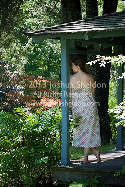 Young woman standing on porch