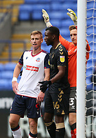 Bolton Wanderers' Eoin Doyle is closely marked by Oldham Athletic's Brice Ntambwe and goalkeeper Laurence Bilboe as they wait for a corner kick<br /> <br /> Photographer Stephen White/CameraSport<br /> <br /> The EFL Sky Bet League Two - Bolton Wanderers v Oldham Athletic - Saturday 17th October 2020 - University of Bolton Stadium - Bolton<br /> <br /> World Copyright © 2020 CameraSport. All rights reserved. 43 Linden Ave. Countesthorpe. Leicester. England. LE8 5PG - Tel: +44 (0) 116 277 4147 - admin@camerasport.com - www.camerasport.com