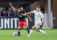 WASHINGTON, DC - MAY 13: Andy Najar #11 of D.C. United dribbles past Przemyslaw Frankowski #11 of Chicago Fire FC during a game between Chicago Fire FC and D.C. United at Audi FIeld on May 13, 2021 in Washington, DC.