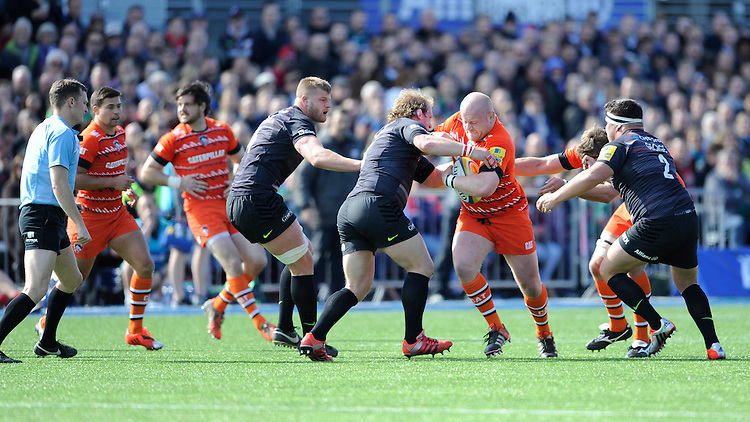 Dan Cole of Leicester Tigers is stopped by Petrus du Plessis and Jamie George of Saracens during the Aviva Premiership Rugby match between Saracens and Leicester Tigers at Allianz Park on Saturday 11th April 2015 (Photo by Rob Munro)