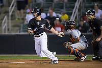 Grant Massey (18) of the Kannapolis Intimidators follows through on his swing against the Delmarva Shorebirds at Kannapolis Intimidators Stadium on April 23, 2016 in Kannapolis, North Carolina.  The Shorebirds defeated the Intimidators 4-2.  (Brian Westerholt/Four Seam Images)