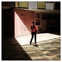 A woman walking through the Sanlitun shopping district in Beijing, China.