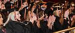 WATERBURY, CT 072421JS22  Graduates applaud the Valedictorian speech by Kat Takita during Post University graduation ceremonies held Saturday at the Palace Theater in Waterbury. This was a commencement for both 2020 and 2021 graduates. <br /> Jim Shannon Republican American
