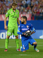 MADRID (SPAIN), OCTOBER, 1, 2014. Miguel Moya of Atlético de Madrid fight for the ball with Fernando Llorente of Juventus de Turín during the football match of Atlético de Madrid vs Juventus de Turín at Vicente Calderóne stadium for UEFA Champions League. PATRICIO REALPE/ASNERP