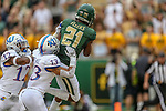 Baylor Bears wide receiver Josh Fleeks (21)and Kansas Jayhawks cornerback Hasan Defense (13) in action during the game between the Kansas Jayhawks and the Baylor Bears at the McLane Stadium in Waco, Texas.