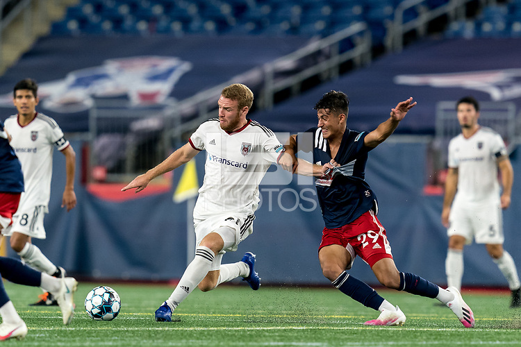 FOXBOROUGH, MA - SEPTEMBER 09: Tanner Dieterich #21 of Chattanooga Red Wolves SC passes the ball as Nicolas Firmino #29 of New England Revolution II closely defends during a game between Chattanooga Red Wolves SC and New England Revolution II at Gillette Stadium on September 09, 2020 in Foxborough, Massachusetts.