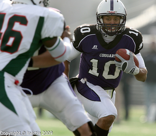 SIOUX FALLS, SD - NOVEMBER 21:  Lorenzo Brown #10 of the University of Sioux Falls picks his way though the defense of Minot State for a touchdown in the first quarter of their first round NAIA playoff game Saturday afternoon at Bob Young Field in Sioux Falls. (Photo by Dave Eggen/Inertia).
