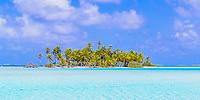 Paradisiac coconut palm trees and white sand motu surrounded by the turquoise lagoon of Rangiroa atoll, Tuamotus archipelago, French Polynesia