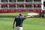 Jeff Overton's approach to the eighteenth green during Round 2 of the CIMB Asia Pacific Classic 2011.  Photo © Raf Sanchez / PSI for Carbon Worldwide