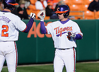 Center fielder Thomas Brittle (4) of the Clemson Tigers is congratulated after scoring a run in the first inning of a game against the Wofford Terriers on Wednesday, March 6, 2013, at Doug Kingsmore Stadium in Clemson, South Carolina. Clemson won, 9-2. (Tom Priddy/Four Seam Images)