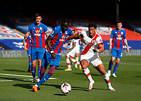 12th September 2020; Selhurst Park, London, England; English Premier League Football, Crystal Palace versus Southampton; Che Adams of Southampton is challenged Cheikhou Kouyate of Crystal Palace