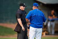 Bluefield Blue Jays manager Dennis Holmberg (35) talks with home plate umpire Adam Clark during a game against the Bristol Pirates on July 26, 2018 at Bowen Field in Bluefield, Virginia.  Bristol defeated Bluefield 7-6.  (Mike Janes/Four Seam Images)
