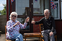 A toast in Welling, Kent, England 8th May 2020. Victory in Europe (VE) 75th Anniversary Celebrations during the UK Lockdown due to the Coronavirus pandemic. Photo by Alan Stanford / PRiME Media Images