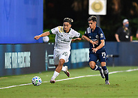 LAKE BUENA VISTA, FL - AUGUST 01: Pablo Bonilla #28 of the Portland Timbers dribbles away from Jesús Medina #19 of New York City FC during a game between Portland Timbers and New York City FC at ESPN Wide World of Sports on August 01, 2020 in Lake Buena Vista, Florida.