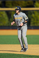 Dillon Everett (2) of the Missouri Tigers takes his lead off of first base against the Radford Highlanders at Wake Forest Baseball Park on February 21, 2014 in Winston-Salem, North Carolina.  The Tigers defeated the Highlanders 15-3.  (Brian Westerholt/Four Seam Images)