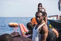 Sea Watch-2.<br /> Die Sea Watch-2 bei ihrer 13. SAR-Mission vor der libyschen Kueste.<br /> Im Bild: Gefluechtete an Bord der Sea Watch-2. Sie haben in der Nacht Freunde verloren. Sie sind ertrunken bervor die Sea Watch-Crew sie erreichen konnte.<br /> 21.10.2016, Mediterranean Sea<br /> Copyright: Christian-Ditsch.de<br /> [Inhaltsveraendernde Manipulation des Fotos nur nach ausdruecklicher Genehmigung des Fotografen. Vereinbarungen ueber Abtretung von Persoenlichkeitsrechten/Model Release der abgebildeten Person/Personen liegen nicht vor. NO MODEL RELEASE! Nur fuer Redaktionelle Zwecke. Don't publish without copyright Christian-Ditsch.de, Veroeffentlichung nur mit Fotografennennung, sowie gegen Honorar, MwSt. und Beleg. Konto: I N G - D i B a, IBAN DE58500105175400192269, BIC INGDDEFFXXX, Kontakt: post@christian-ditsch.de<br /> Bei der Bearbeitung der Dateiinformationen darf die Urheberkennzeichnung in den EXIF- und  IPTC-Daten nicht entfernt werden, diese sind in digitalen Medien nach §95c UrhG rechtlich geschuetzt. Der Urhebervermerk wird gemaess §13 UrhG verlangt.]