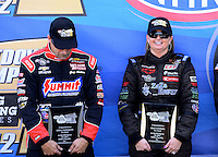 Sept. 14, 2012; Concord, NC, USA: NHRA pro stock driver Greg Anderson (left) with Erica Enders and Vincent Nobile during qualifying for the O'Reilly Auto Parts Nationals at zMax Dragway. Mandatory Credit: Mark J. Rebilas-