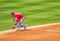 20 April 2013: Washington Nationals shortstop Ian Desmond bobbles a grounder during game action against the New York Mets at Citi Field in Flushing, NY. The Nationals defeated the Mets 7-6 to tie their 3-game series at one a piece. Mandatory Credit: Ed Wolfstein Photo *** RAW (NEF) Image File Available ***