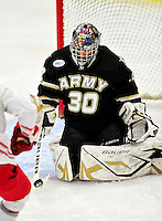 2 January 2011: Army Black Knight goaltender Ryan Leets, a Sophomore from Kentwood, MI, stops Ohio State University Buckeye forward Sergio Somma, a Senior from  Pittsburgh, PA, at Gutterson Fieldhouse in Burlington, Vermont. The Buckeyes defeated the Black Knights 5-3 to win the 2010-2011 Catamount Cup. Mandatory Credit: Ed Wolfstein Photo