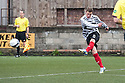 Shire's David Greenhill scores their first goal.