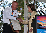 North Lake Tahoe Fire Protection District Fire Chief Mike Brown accepts a proclamation from U.S. Sen. Dianne Feinstein during the 18th annual Lake Tahoe Summit at the Valhalla Estate in South Lake Tahoe, Ca., on Tuesday, Aug. 19, 2014.  <br /> Photo by Cathleen Allison