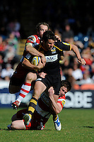 Hugo Southwell of London Wasps runs the gauntlet between James Simpson-Daniel (left) and Henry Trinder of Gloucester Rugby during the Aviva Premiership match between London Wasps and Gloucester Rugby at Adams Park on Sunday 1st April 2012 (Photo by Rob Munro)