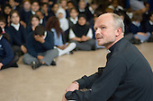 Reverend Graham Buckle conducts morning assembly at Christ Church Bentinck  C of E Primary School, Marylebone. London
