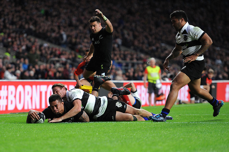 Vaea Fifita of New Zealand scores a try despite the efforts of George Bridge of Barbarians during the 125th Anniversary Match between Barbarians and New Zealand at Twickenham Stadium on Saturday 4th November 2017 (Photo by Rob Munro/Stewart Communications)