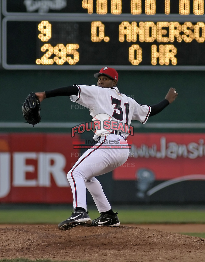 April 21, 2004:  Pitcher Adalberto Mendez of the Lansing Lugnuts, Low-A Midwest League affiliate of the Chicago Cubs, during a game at Oldsmobile Park in Lansing, MI.  Photo by:  Mike Janes/Four Seam Images