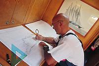 - leisure sailing boat in navigation on the Southern Mediterranean sea, sailor to nautical map table....- barca a vela da diporto in navigazione nel mare Mediterraneo Meridionale, marinaio al tavolo di carteggio