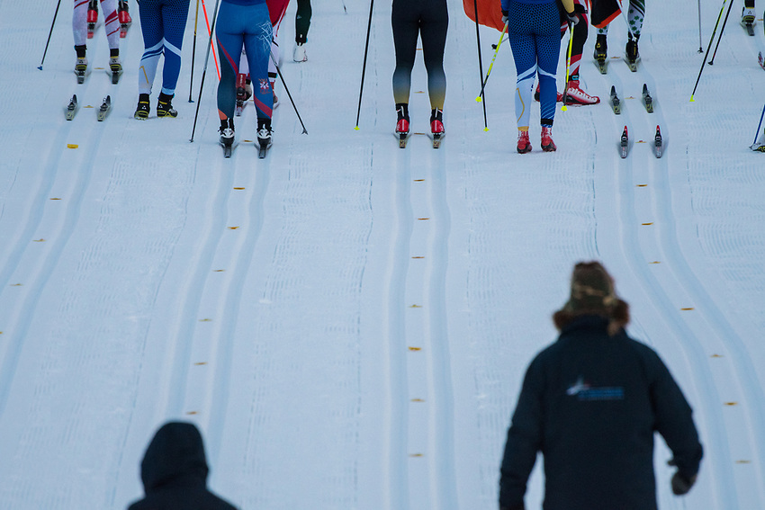 Officials watch as racers take their positions on starting marks before the Women's 20k Classic during the 2018 U.S. National Cross Country Ski Championships at Kincaid Park in Anchorage.