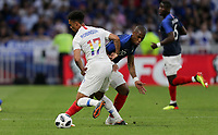 Lyon, France - Saturday June 09, 2018: Antonee Robinson, Djibril Sidibe during an international friendly match between the men's national teams of the United States (USA) and France (FRA) at Groupama Stadium.