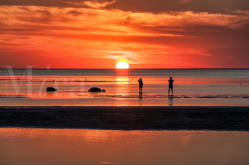 Photographers take sunset photos at Skaket beach, Cape Cod, Massachusetts, USA