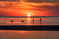 Photographers take sunset photos at Skaket beach, Cape Cod, Massachusetts, USA