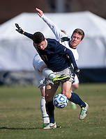 Tom Skelly (17) of Georgetown fights for the ball with Brent McIntosh (8) of Michigan State during the third round of the NCAA tournament at Shaw Field in Washington, DC. Michigan State defeated Georgetown, 1-0.