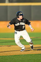 Conor Keniry (14) of the Wake Forest Demon Deacons takes his lead off of second base against the West Virginia Mountaineers at Wake Forest Baseball Park on February 24, 2013 in Winston-Salem, North Carolina.  The Demon Deacons defeated the Mountaineers 11-3.  (Brian Westerholt/Four Seam Images)