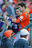 Left fielder Steven Duggar (9) is congratulated in the dugout as he scores Clemson's first run in the Reedy River Rivalry game against the South Carolina Gamecocks on March 1, 2014, at Fluor Field at the West End. South Carolina won, 10-2. (Tom Priddy/Four Seam Images)