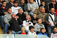 ATTENTION SPORTS PICTURE DESK<br /> Pictured: Swansea City fans in action <br /> Re: Coca Cola Championship, Swansea City Football Club v Cardiff City FC at the Liberty Stadium, Swansea, south Wales. Saturday 07 November 2009