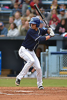 Asheville Tourists center fielder Max White #13 swings at a pitch during a game against the  Greenville Drive at McCormick Field on May 17, 2014 in Asheville, North Carolina. The Tourists defeated the Drive 14-6. (Tony Farlow/Four Seam Images)