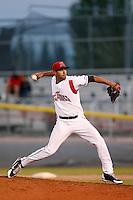 Eduardo Encinosa of the Salem-Keizer Volcanoes pitches against the Tri-City Dust Devils at Volcanoes Stadium on July 27, 2013 in Keizer, Oregon. Tri-City defeated Salem-Keizer, 5-4. (Larry Goren/Four Seam Images)