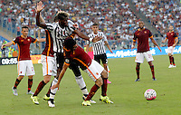 Calcio, Serie A: Roma vs Juventus. Roma, stadio Olimpico, 30 agosto 2015.<br /> Juventus' Paul Pogba, left, and Roma's Mohamed Salah fight for the ball during the Italian Serie A football match between Roma and Juventus at Rome's Olympic stadium, 30 August 2015.<br /> UPDATE IMAGES PRESS/Riccardo De Luca