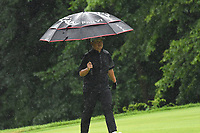 11th July 2021, Silvis, IL, USA; Sunglae Im is shown with his umbrella during a rain shower during the final round of the John Deere Classic on July 11, 2021, at TPC Deere Run, Silvis, IL.