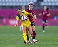 KASHIMA, JAPAN - AUGUST 5: Hayley Raso #16 of Australia fights for the ball with Megan Rapinoe #15 of the USWNT during a game between Australia and USWNT at Kashima Soccer Stadium on August 5, 2021 in Kashima, Japan.