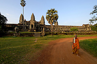 Images from the Book Journey Through Colour and Time, Buddhist Monk walking back to his Monestary at sunset at Angkor Wat, Cambodia