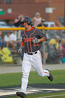 North Davidson High School Black Knights center fielder  Austin Beck (23)  rounding the bases after homering during a game against the West Brunswick High School Trojans at Mike Alderson Field  on April 12, 2017 in Shallotte, North Carolina. North Davidson defeated West Brunswick 7-3. (Robert Gurganus/Four Seam Images)