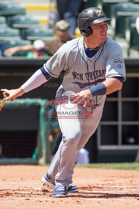 New Orleans Zephyrs first baseman Justin Bour (41) watches a hits a ball during the Pacific League game at the Chickasaw Bricktown Ballpark against the Oklahoma City RedHawks on April 13, 2014 in Oklahoma City, Oklahoma.  The RedHawks defeated the Zephyrs 4-3.  (William Purnell/Four Seam Images)